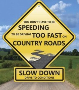 Slow Down on Country Roads Sign